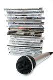 Microphone and karaoke compact discs collection. Microphone and karaoke compact disc collection on white background Stock Images