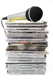 Microphone and karaoke compact discs collection. Microphone and karaoke compact disc collection on white background Royalty Free Stock Photo