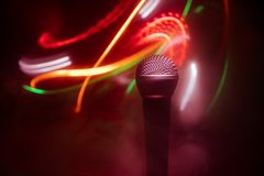 Microphone karaoke, concert . Vocal audio mic in low light with blurred background. Live music, audio equipment. Karaoke concert,. Microphone for sound, music royalty free stock images