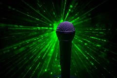 Microphone karaoke, concert . Vocal audio mic in low light with blurred background. Live music, audio equipment. Karaoke concert,. Microphone for sound, music stock image