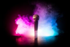 Microphone karaoke, concert . Vocal audio mic in low light with blurred background. Live music, audio equipment. Karaoke concert,. Microphone for sound, music stock photo