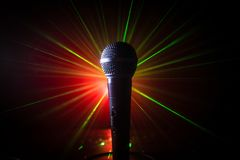 Microphone karaoke, concert . Vocal audio mic in low light with blurred background. Live music, audio equipment. Karaoke concert,. Microphone for sound, music stock images
