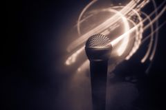Microphone karaoke, concert . Vocal audio mic in low light with blurred background. Live music, audio equipment. Karaoke concert,. Microphone for sound, music royalty free stock image