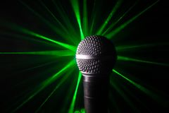 Microphone karaoke, concert . Vocal audio mic in low light with blurred background. Live music, audio equipment. Karaoke concert,. Microphone for sound, music stock photography