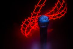 Microphone karaoke, concert . Vocal audio mic in low light with blurred background. Live music, audio equipment. Karaoke concert,. Microphone for sound, music royalty free stock photos