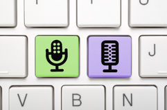 Microphone key on keyboard Stock Photography