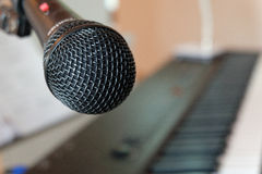 Microphone. A microphone with keyboard background Stock Images