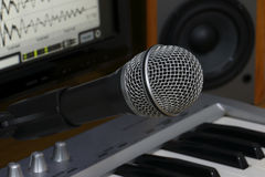 Microphone and keyboard. Royalty Free Stock Image