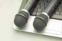 Microphone And Keyboard. Microphone on the keyboard. Music and singing royalty free stock image
