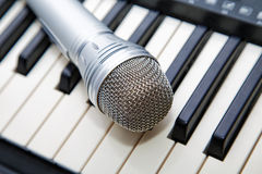 Microphone on the keyboard Stock Photo