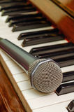 Microphone on keyboard of piano. Microphone on the keyboard of classical piano Royalty Free Stock Photos