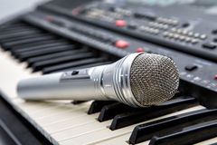 Microphone on keys of a musical Stock Images