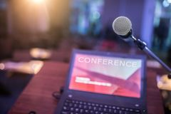 Microphone and laptop computer at podium on business seminar in conference room.  stock images