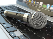 Microphone on the laptop keyboard. Digital audio  music software Stock Photo