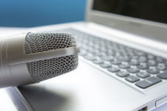 Microphone on laptop - sound editing concept Royalty Free Stock Photo