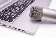 Microphone on laptop - sound recording concept Stock Images