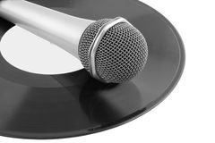 Microphone laying on vinyl records Stock Image