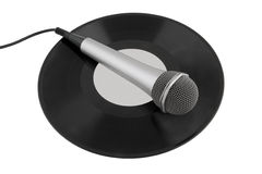 Microphone laying on vinyl records Royalty Free Stock Images