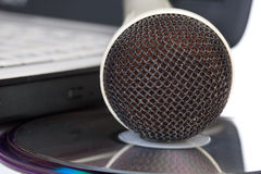 The microphone lays on  compact discs Stock Images