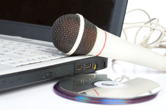 The microphone lays on notebook Stock Images