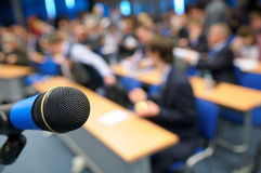 Microphone in the Lecture Hall. Royalty Free Stock Photos