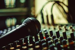 The microphone lies on the mixer Royalty Free Stock Photo