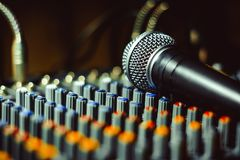 The microphone lies on the mixer Stock Image