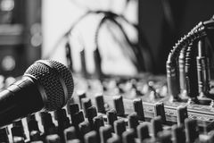 The microphone lies on the mixer Stock Photo