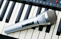 The microphone lies on the synthesizer Royalty Free Stock Images