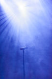 Microphone lit by a floodlight Royalty Free Stock Photos