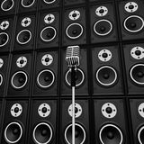 Microphone And Loud Speakers Shows Music. Microphone And Loud Speakers Showing Music Industry Performing Or Entertaining Royalty Free Stock Images