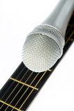 Microphone lying on a fingerboard Stock Photography