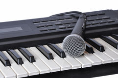 A microphone lying on the keys Stock Images