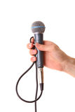 Microphone in male hand isolated on white Stock Images
