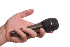 Microphone in the man's hand Royalty Free Stock Image
