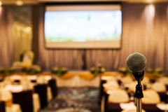 Microphone in meeting room. Royalty Free Stock Image
