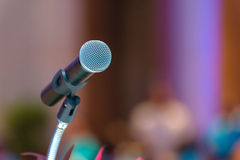 Microphone in meeting room before a conference Stock Photography