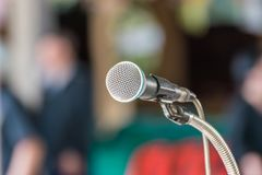 Microphone in meeting room use for amplify talk. Microphone in seminar event or meeting room use mic for sound amplify when talk or communicate on stage defocus stock photos