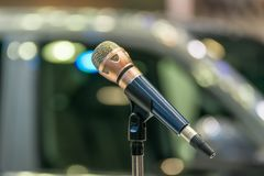 Microphone in meeting room use for amplify talk. Microphone in seminar event or meeting room use mic for sound amplify when talk or communicate on stage defocus stock images