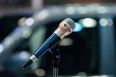 Microphone in meeting room use for amplify talk. Microphone in seminar event or meeting room use mic for sound amplify when talk or communicate on stage defocus royalty free stock image
