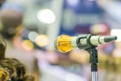 Microphone in meeting room use for amplify talk. Microphone in seminar event or meeting room use mic for sound amplify when talk or communicate on stage defocus royalty free stock photos
