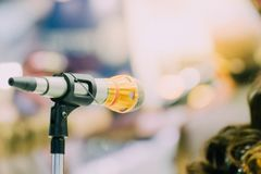 Microphone in meeting room use for amplify talk. Microphone in seminar event or meeting room use mic for sound amplify when talk or communicate on stage defocus royalty free stock images