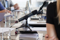 Microphone at meeting table Stock Photos