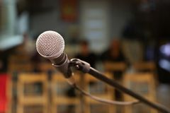 A microphone with a metal grid on the stage, will sing for the audience. A small concert hall royalty free stock photography