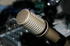 Microphone and Mixer. Studio microphone above sound mixer Stock Photography