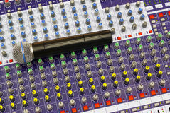 Microphone on the mixing desk Stock Images