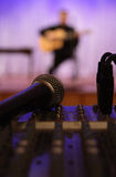 Microphone and mixing desk. Sound check before a concert. View from place of sound operator Stock Image