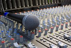 Microphone on the mixing desk Stock Image