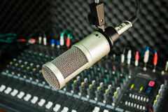 Microphone. And the mixing desk sound studio background Stock Photography