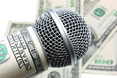 Microphone and money. On white Royalty Free Stock Photos